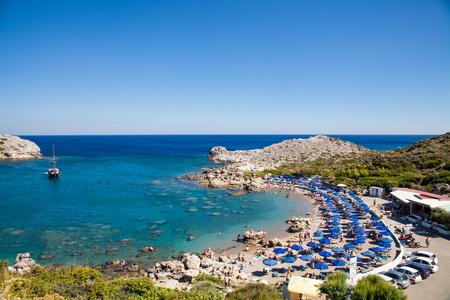 stony coral: Beach off the coast of the island of Rhodes in Faliraki, Greece. Seaside landscape. Rocky coast and sea.Bay off the coast of faliraki on the rhodos. Editorial