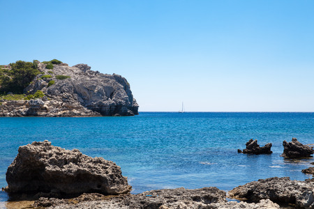 Beach off the coast of the island of Rhodes in Greece. Seaside landscape. Rocky coast and sea.