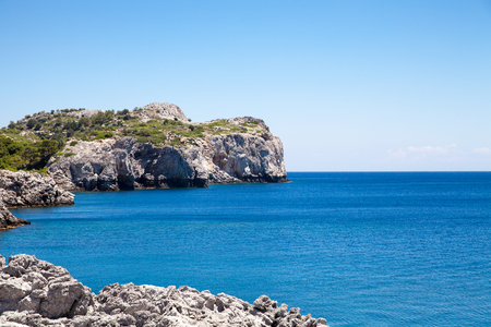 stony coral: Beach off the coast of the island of Rhodes in Faliraki, Greece. Seaside landscape. Rocky coast and sea. Editorial