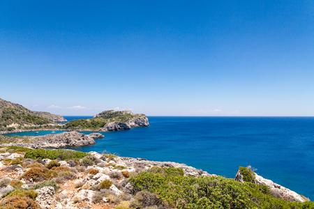 salinity: Beach off the coast of the island of Rhodes in Faliraki, Greece. Seaside landscape. Rocky coast and sea.Bay off the coast of faliraki on the rhodos. Editorial