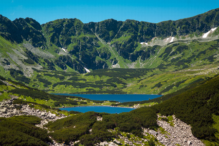 Tatras mountains, Valley of five ponds. View on mountains and two lakes. Trail to see eye from the mountain hostel in five ponds.  Five breathtaking mountain lakes in the High Tatras. Stock Photo