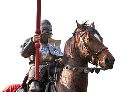 Knight on horseback. Horse in armor with knight holding lance. Horses on the medieval battlefield. Stock Photo