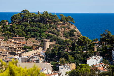 View of the town of Tossa de mar one of the most beautiful towns on the Costa Brava. City walls and medieval castle on the hill. Amazing city in Girona, architecture and monuments of Catalonia. Editorial