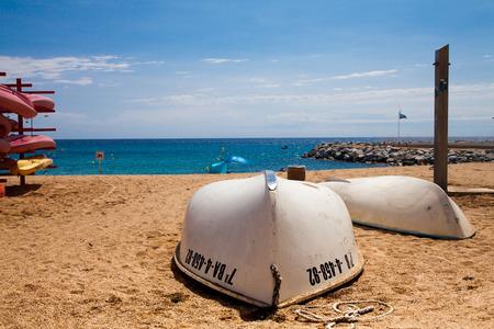 Two boats on the beach. Mediterranean coast. Beautiful beach and harbor between the cities of Lloret de mar and Tossa de mar. Standard-Bild