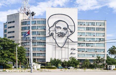 Havana / Cuba - November 27, 2017: Plaza de la Revolucion Face Camilo Cienfuegos, Havana, Cuba. Ministry of Communications and Camilo Cienfuegos memorial. Stock Photo - 128140142