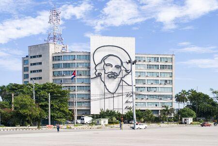 Havana / Cuba - November 27, 2017: Plaza de la Revolucion Face Camilo Cienfuegos, Havana, Cuba. Ministry of Communications and Camilo Cienfuegos memorial. Stock Photo - 128140146