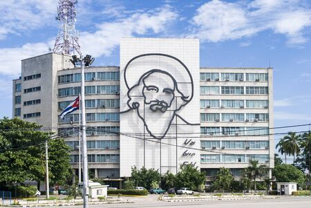 Havana / Cuba - November 27, 2017: Plaza de la Revolucion Face Camilo Cienfuegos, Havana, Cuba. Ministry of Communications and Camilo Cienfuegos memorial. Stock Photo - 128140152
