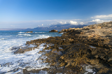The rocks are in contact with the sea. Rocky beach, sharp rocks. Greece, island of Crete. Archivio Fotografico