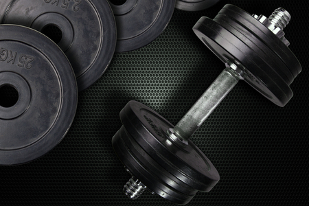 Dumbells and weights on a carbon background.