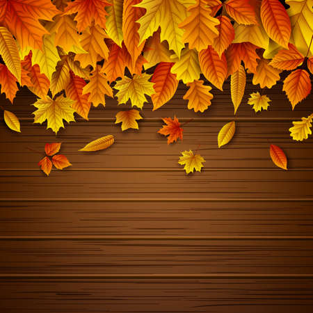Wooden background with autumn leaves falling