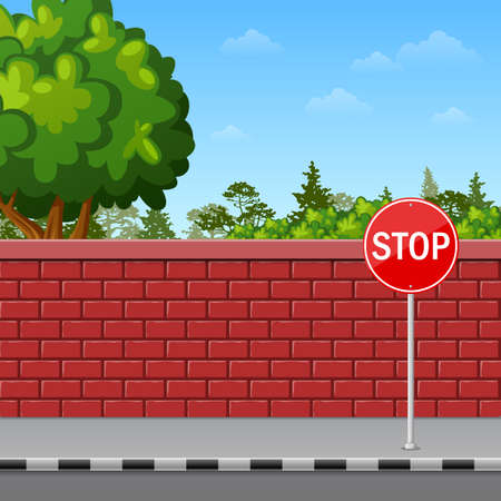 Brick wall with stop sign on the pavement Stock Photo