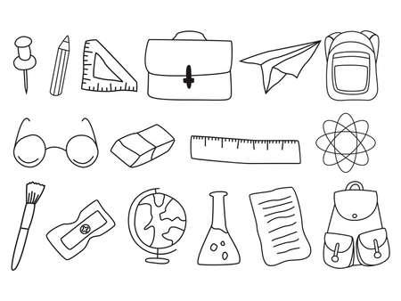 Conjunto de útiles escolares aislado sobre fondo blanco.