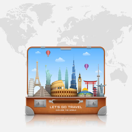 Travel around the world concept. Open suitcase with landmarks