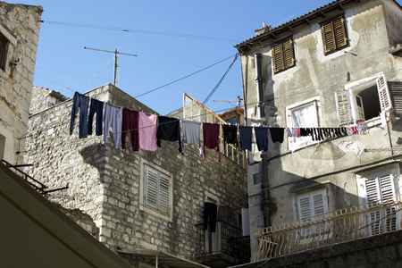 wet clothes: Tiramol - a rope of cable between two walls, for hanging wet clothes in the sun