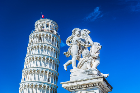 leaning tower of pisa: Statue of angels and Leaning tower, Pisa Italy.