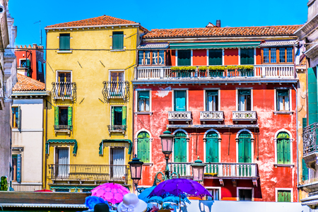 umbrela: Mediterranean architecture in Italy, square vintage in classic colorful style.