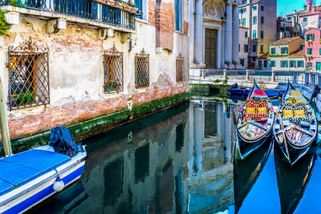 Water streets and canals in unique touristic Venice city, Italy.