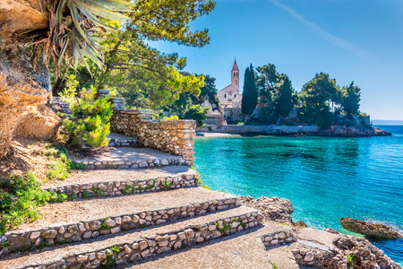 brac: Ancient dominican monastery is landmark in town of Bol, Island of Brac, Croatia. Selective focus. Stock Photo