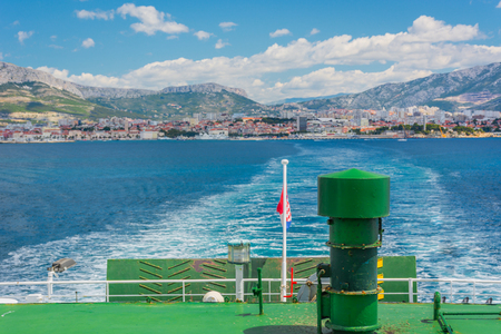 owning: View at city Split in background from ferry, Croatia summertime. Stock Photo