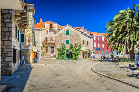 View at colorful mediterranean promenade in town Supetar, Island Brac, Croatia.