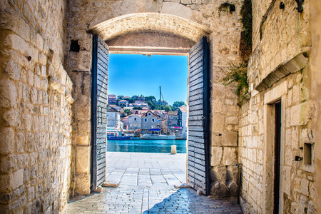 View at architecture and stone city gate in Trogir, Croatia.