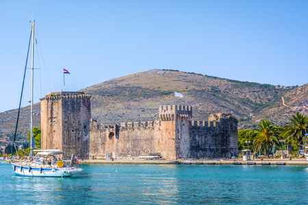 croatian: Waterfront scenic view at fortress Kamerlengo, famous landmark in Trogir town, croatian travel places.