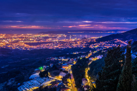 Night scenic view at cityscape of town Split and suburb from upper hills in background, Croatia, european travel places. Imagens