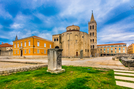 Dramatic sky over Roman Forum in famous historic place Zadar, Dalmatia region, Croatia. Imagens
