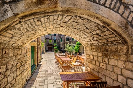 Stone gate entrance in Dalmatia, old famous touristic region in Croatia, Island Hvar. Stock Photo