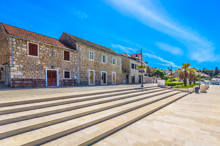 Colorful sunny scenery at promenade in town Starigrad, Island Hvar summertime, Europe.