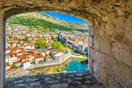 srd: Scenic view through stone window at Dubrovnik coastline, Croatia.