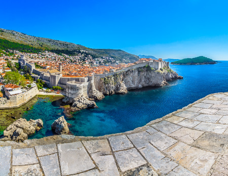 Scenic aerial view on coastline of Dubrovnik town, famous touristic attraction in Croatia, Europe. Stock Photo
