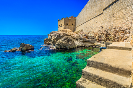 unesco: Seafront view at coastline beneath City Walls in Dubrovnik, Croatia.