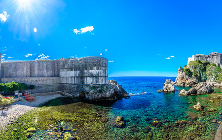 ragusa: Summer panorama of sunny beach with forts around, Croatia Dubrovnik. Stock Photo