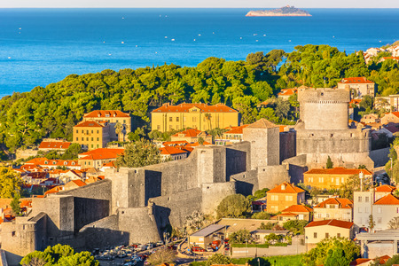 Aerial view at City Walls in famous tourist resort Dubrovnik, Croatia. Stock Photo