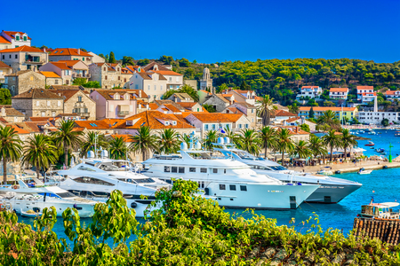 Summer view at luxury yachts in Hvar town, mediterranean place on Adriatic Coast. Stok Fotoğraf