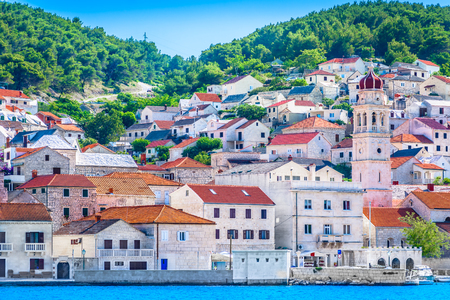 Waterfront view at small picturesque town Pucisca on Adriatic Coast, Island Brac scenery.