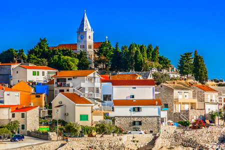 Scenic view at old medieval town Primosten in Croatia, summer travel destinations.
