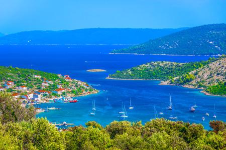 Aerial view at picturesque marble bay in Vinisce region, Dalmatia Croatia.