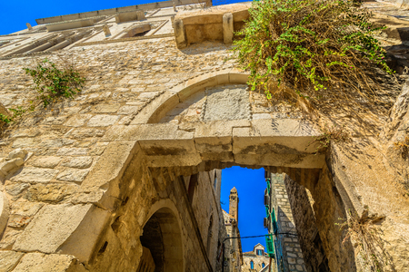Scenic view at old city gate in Hvar town, famous ancient town in Croatia, Mediterranean.