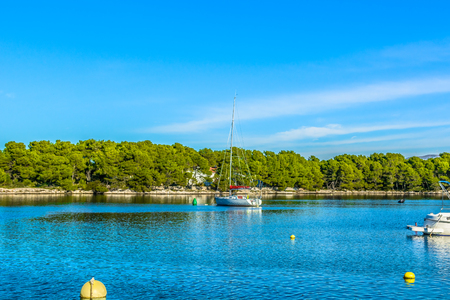 Seafront view at bay in suburb of town Sibenik, Northern Dalmatia in Croatia.