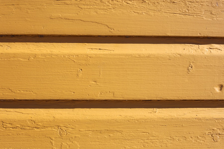 Yellow, pretty and simultaneously rustic wall photographed in Porvoo, Finland