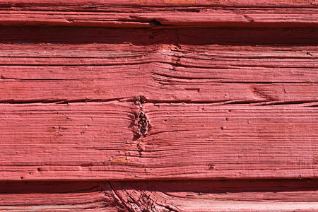 Red, pretty and simultaneously rustic wall photographed in Porvoo, Finland