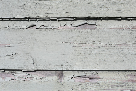 White, pretty and simultaneously rustic wall photographed in Porvoo, Finland