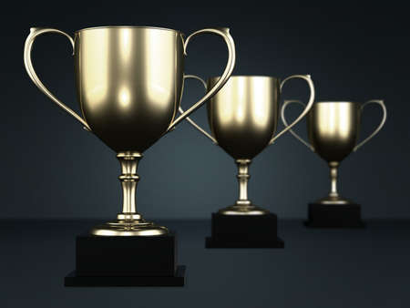 award winning: Golden cup trophies isolated on a dark background.