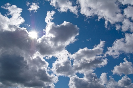 Real sun in the beautiful clouds. Stock Photo - 15806279