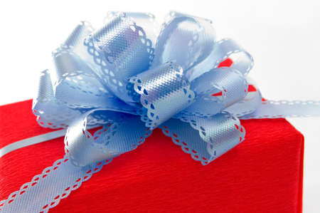 Red gift with blue bow. Stock Photo - 15806276