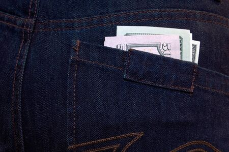 Dollars in the pocket of jeans. photo