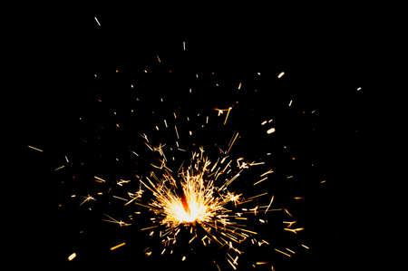 dangerously: Christmas sparkler on black background
