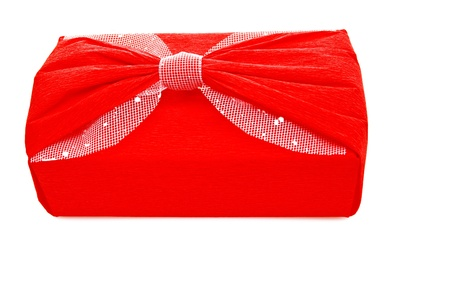 Red gift with bow on white. Stock Photo - 16358141